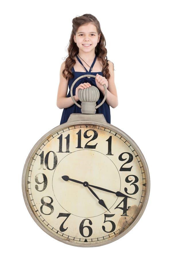 Mädchen mit einer Uhr stockbild