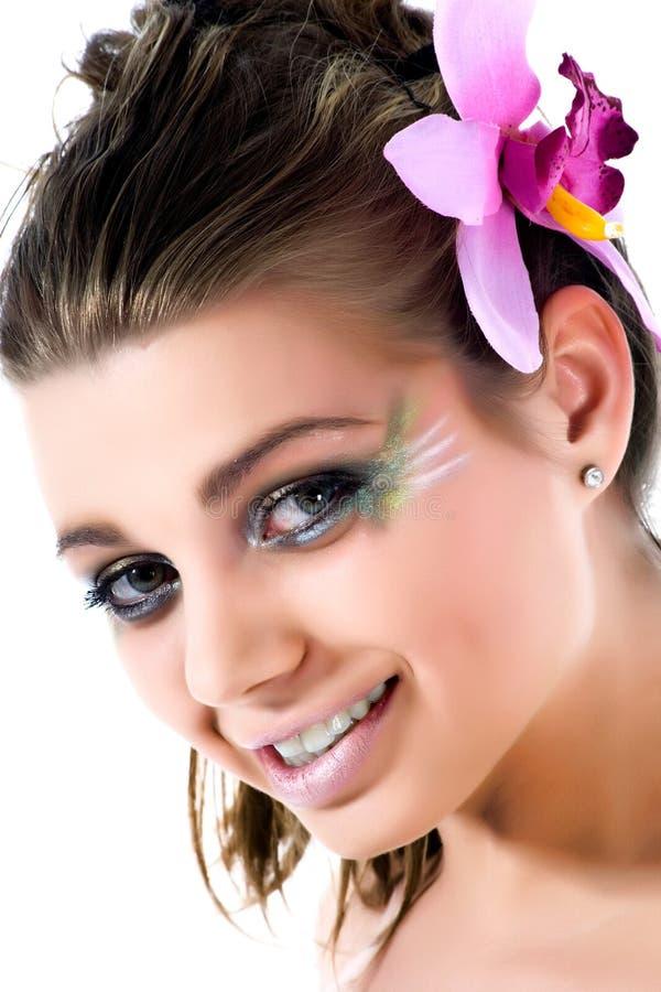 Mädchen mit Gesichtkunst Basisrecheneinheitslack lizenzfreie stockfotos