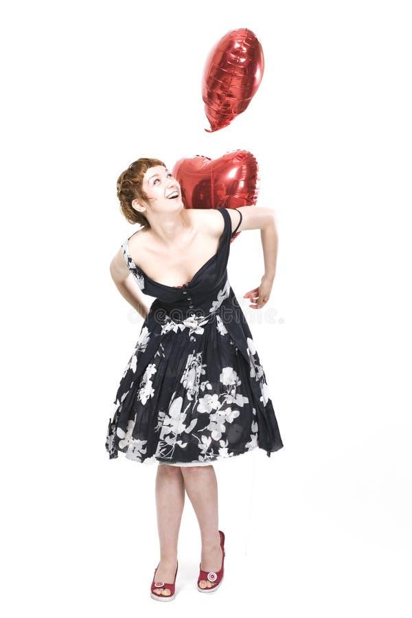 Mädchen mit heart-shaped Ballonen lizenzfreies stockbild