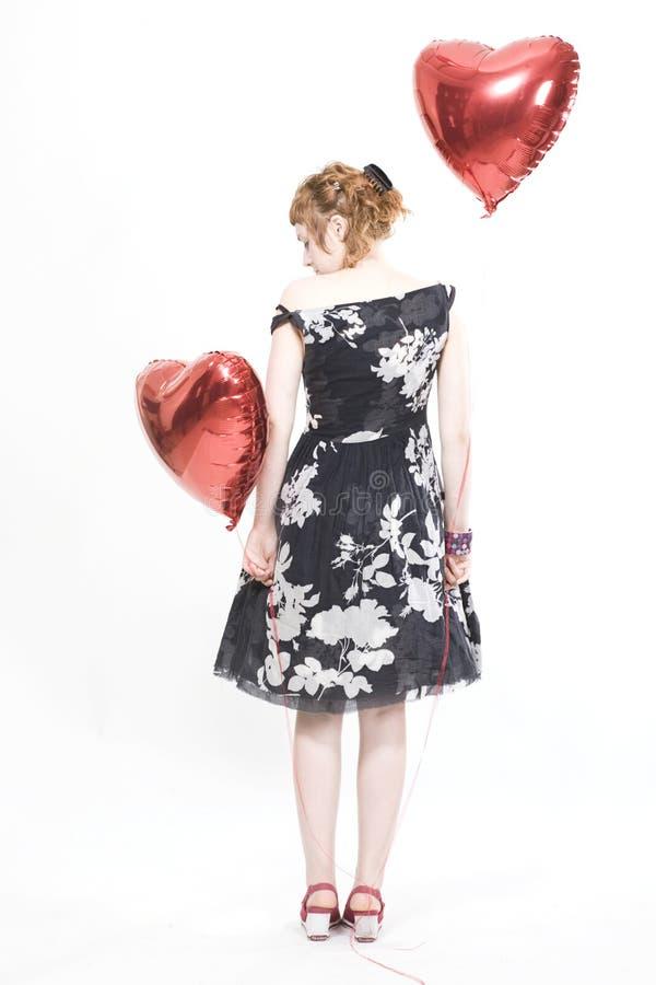 Mädchen mit heart-shaped Ballonen lizenzfreies stockfoto