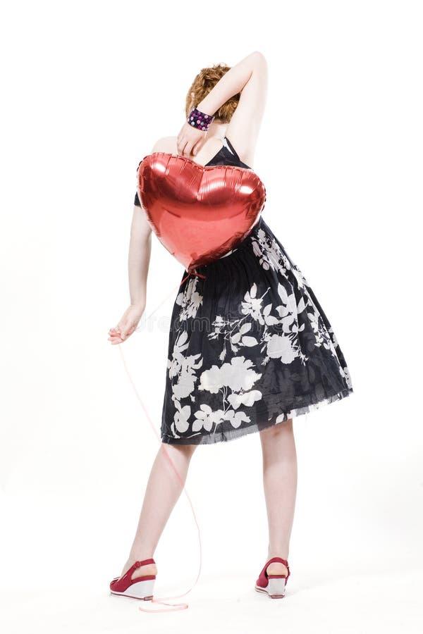 Mädchen mit heart-shaped Ballonen stockfotografie