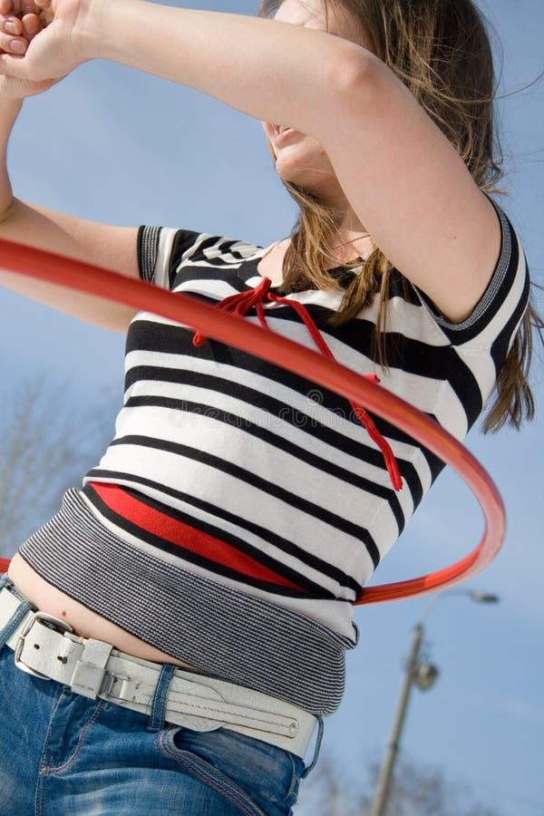 Download Mädchen mit hula Band stockfoto. Bild von band, freude - 9078428