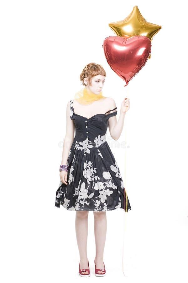 Mädchen mit Innerem und sternförmigen Ballonen lizenzfreies stockfoto