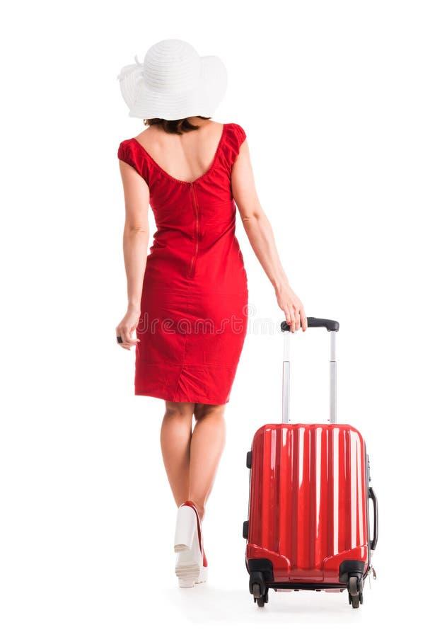Mädchen mit Koffer im Studio stockfoto