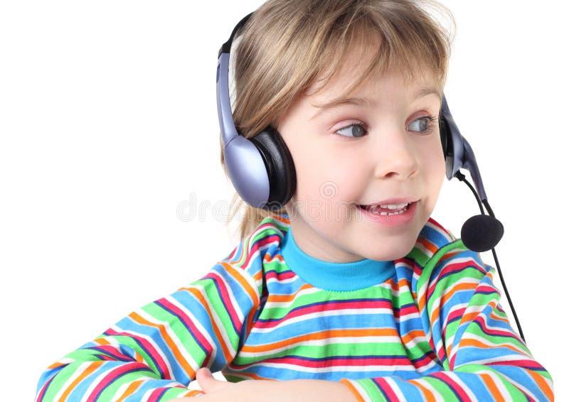 Mädchen mit Kopfhörern und Mikrofon lizenzfreies stockbild