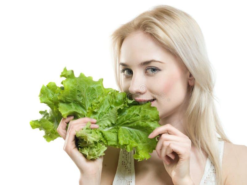 Mädchen mit Kopfsalat lizenzfreies stockfoto