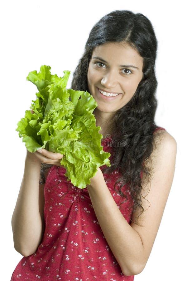 Mädchen mit Kopfsalat lizenzfreies stockbild