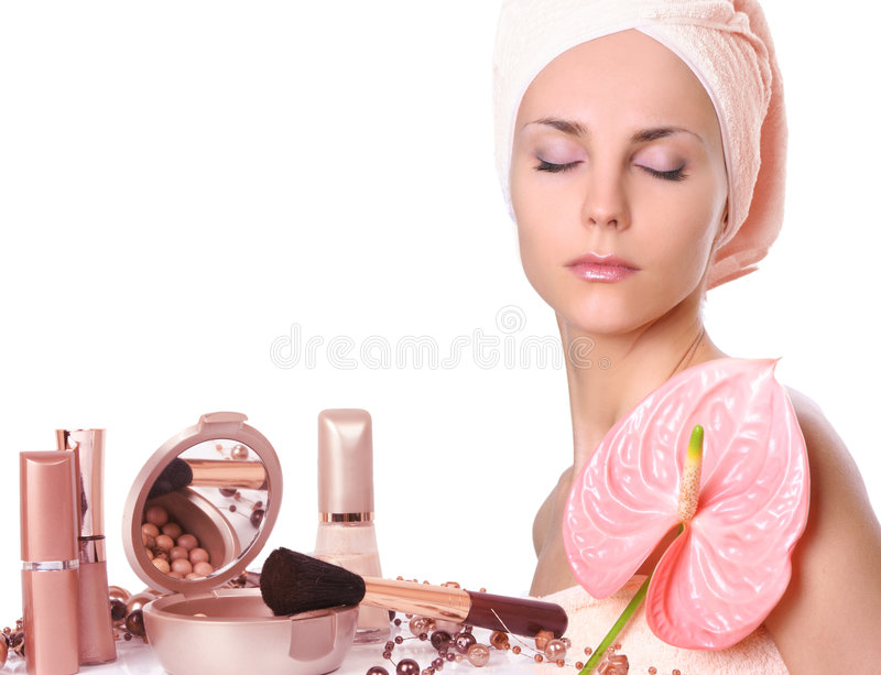 Mädchen mit Kosmetik lizenzfreie stockbilder