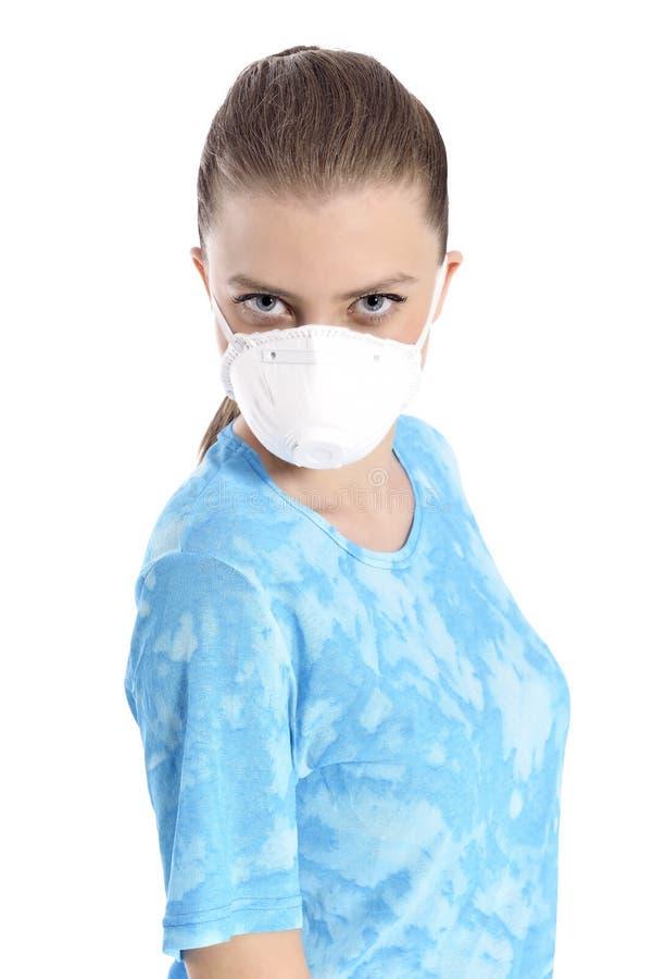 Mädchen mit Maske gegen Schweinegrippe lizenzfreie stockfotografie