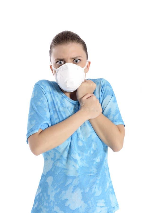 Mädchen mit Maske gegen Schweinegrippe lizenzfreies stockfoto