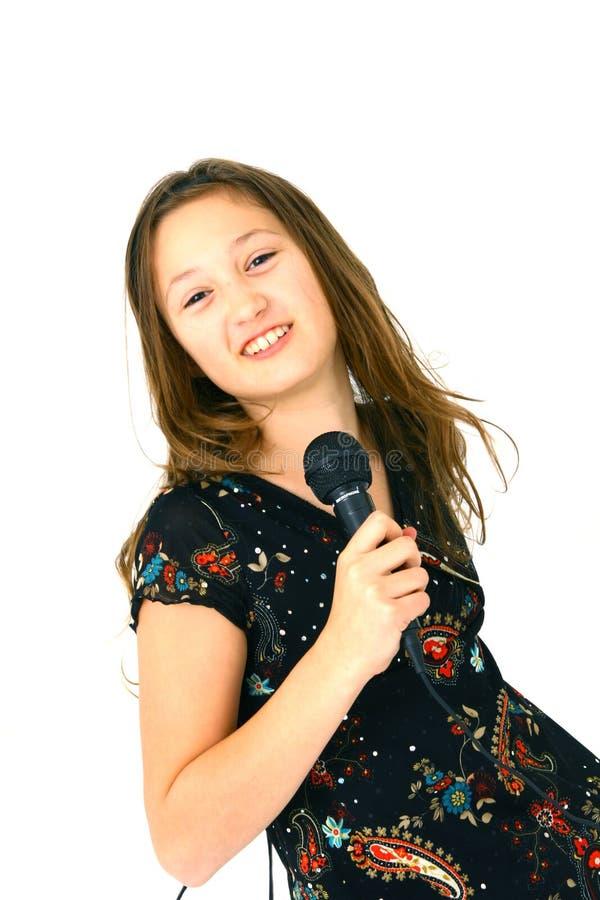 Mädchen mit Mikrofon lizenzfreies stockbild
