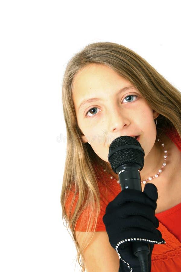 Mädchen mit Mikrofon lizenzfreie stockbilder