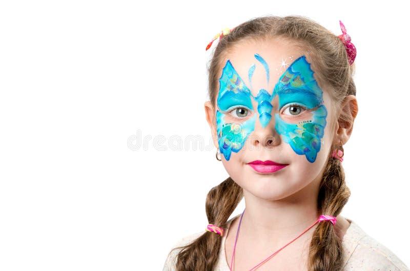 Mädchen mit moderner Schmetterlingsgesichtskunst lizenzfreies stockfoto
