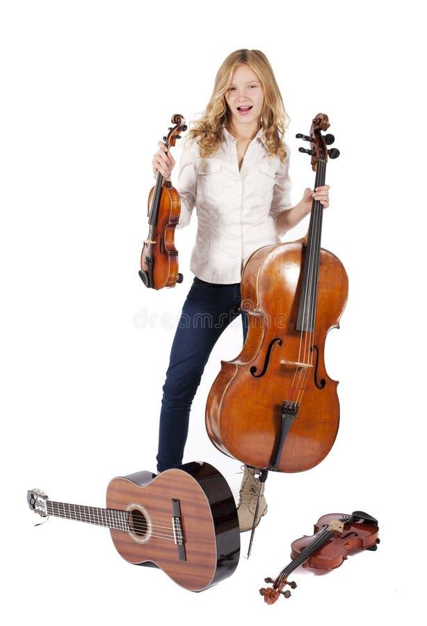 Mädchen mit Musikinstrumenten lizenzfreies stockbild