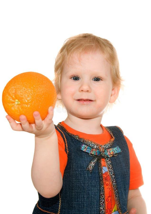 Mädchen mit Orange lizenzfreie stockfotografie