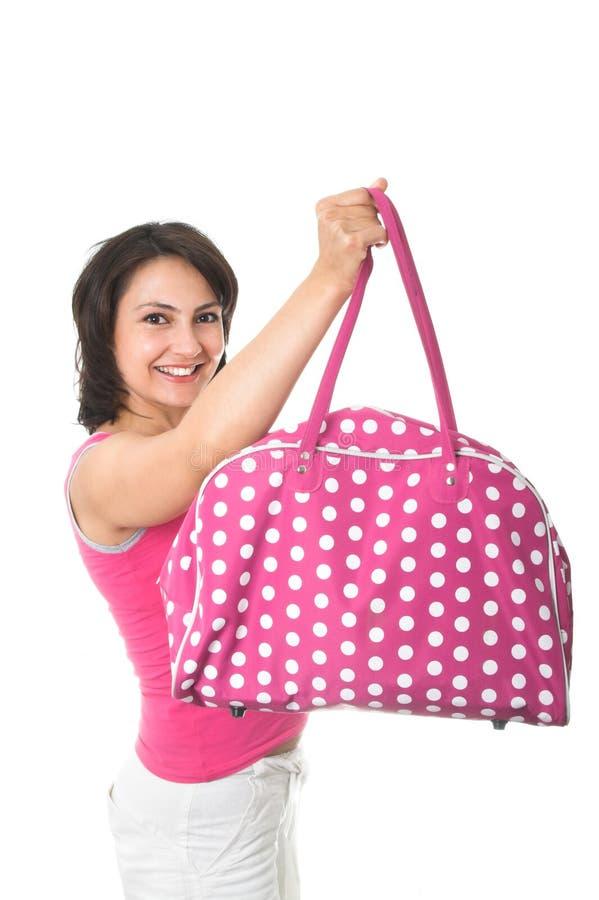 Mädchen mit rosafarbener Handtasche lizenzfreie stockfotografie