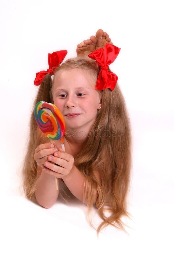 Mädchen mit roten Verkleidungen lizenzfreies stockbild