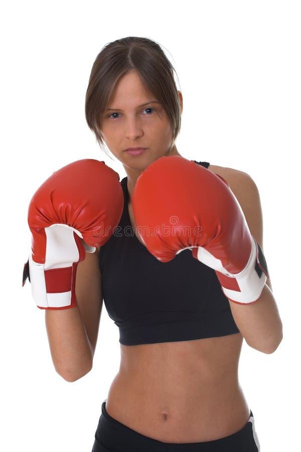Mädchen mit roten Verpackenhandschuhen stockfotografie