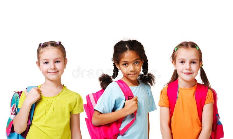 Mädchen mit Rucksäcken stockbild