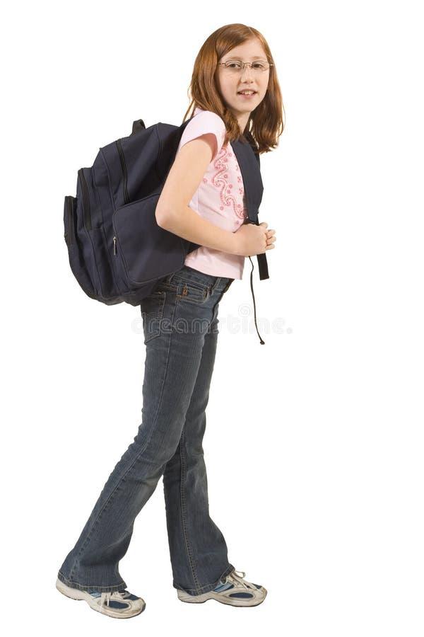 Mädchen mit Rucksack lizenzfreie stockfotografie