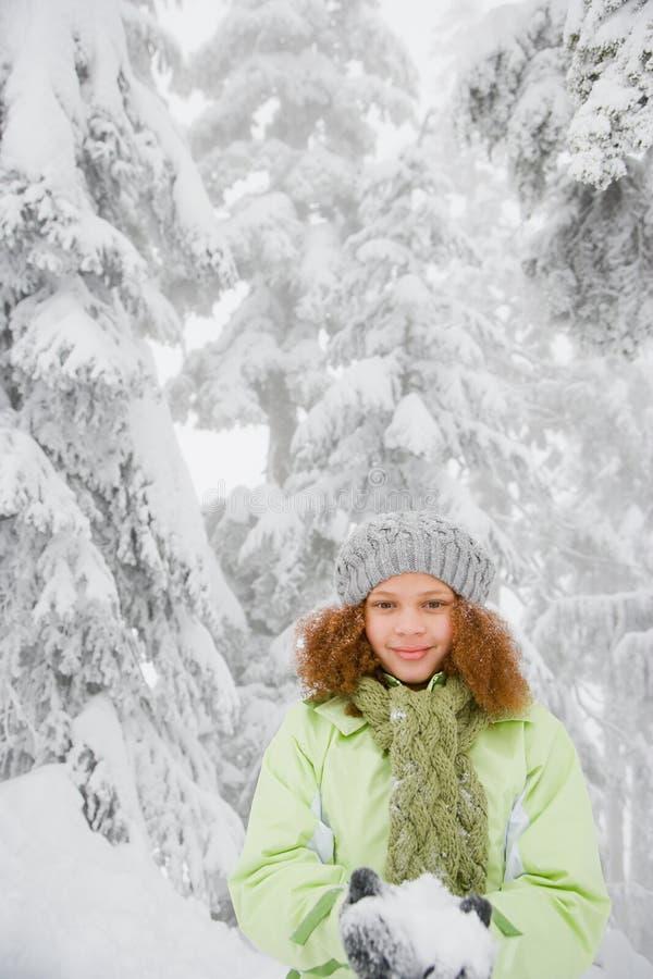 Mädchen mit Schnee lizenzfreies stockbild