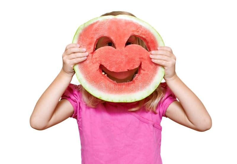 Mädchen mit smiley der Wassermelone lizenzfreies stockfoto