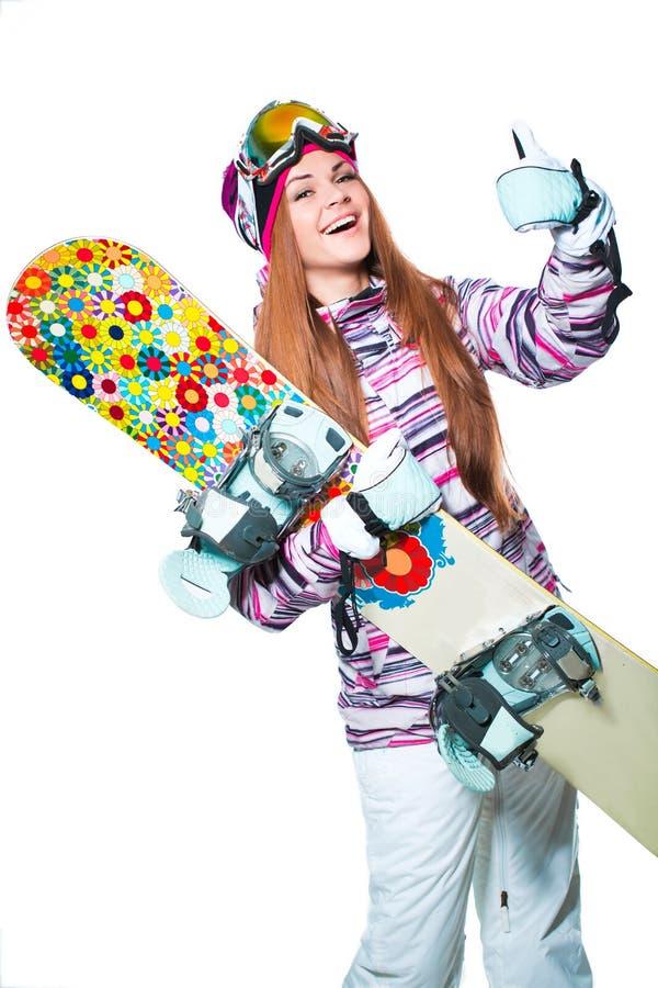 Mädchen mit Snowboard stockbilder