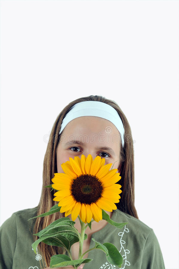 Mädchen mit Sonnenblume stockbilder