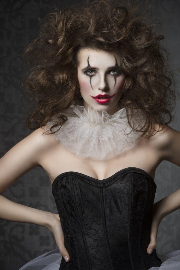 Mädchen mit verrückter Clownweinleseart lizenzfreie stockbilder