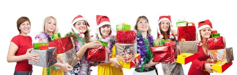Mädchen mit Weihnachtsgeschenken über Weiß lizenzfreie stockbilder