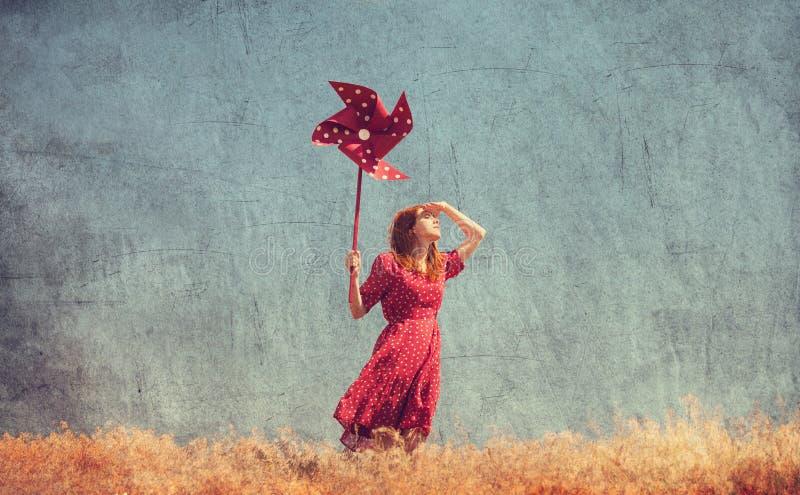 Mädchen mit Windkraftanlage lizenzfreie stockfotos