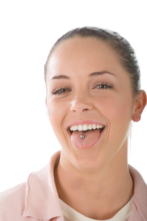 Mädchen mit Zungedurchdringen lizenzfreie stockbilder