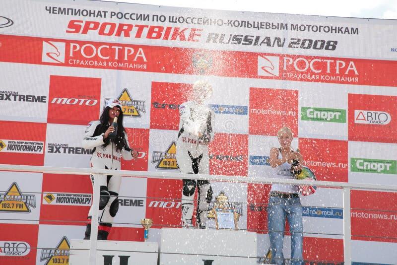 Mädchen-Motorradfahrer auf Bedienpult stockbild
