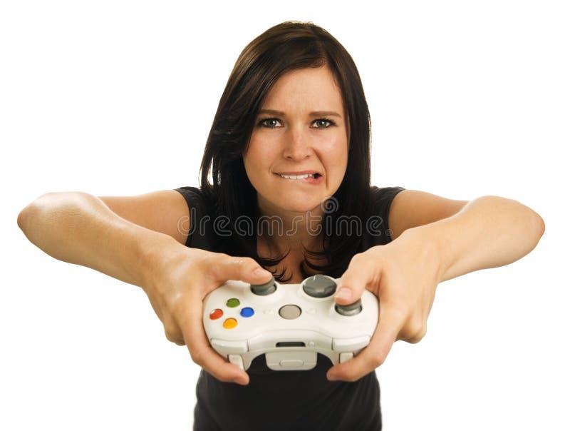 Mädchen spielt Videospiel stockfotos