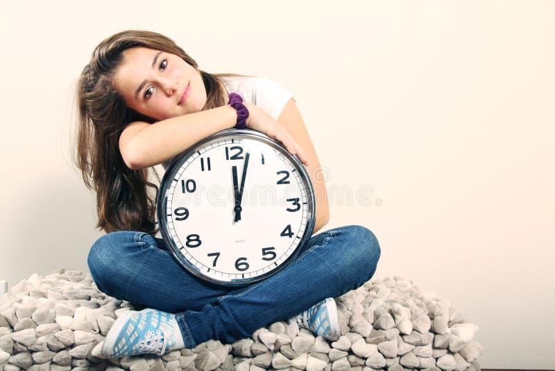 Mädchen und Borduhr stockbilder