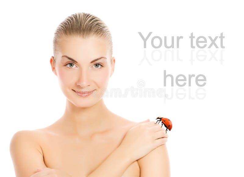 Mädchen und ein Marienkäfer stockbild