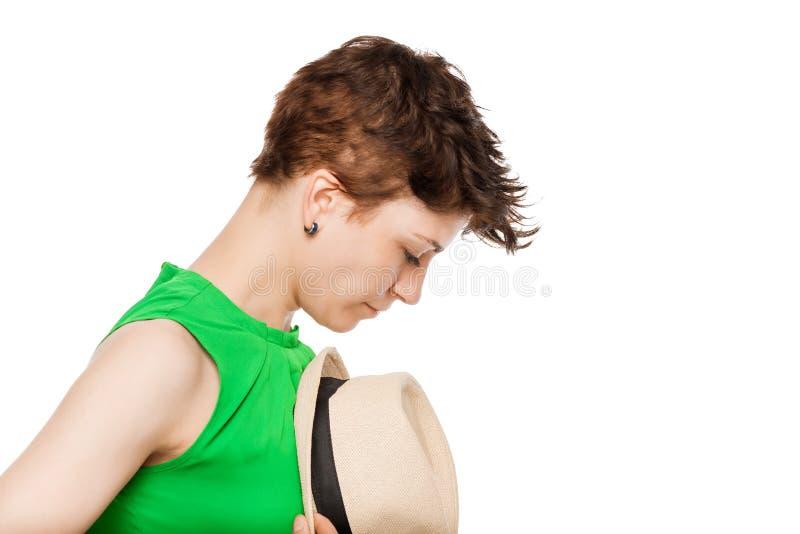 Mädchen und ihr Hut, Porträt auf einem Weiß stockbilder