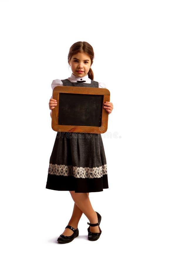 Mädchen und Tafel stockbilder