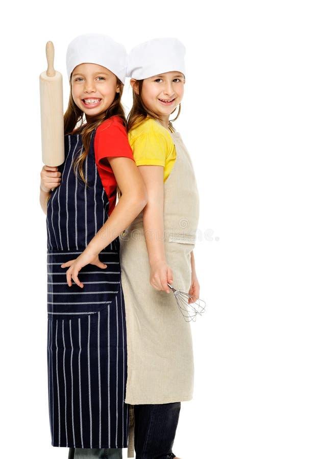 Mädchenchefkoch lizenzfreies stockbild