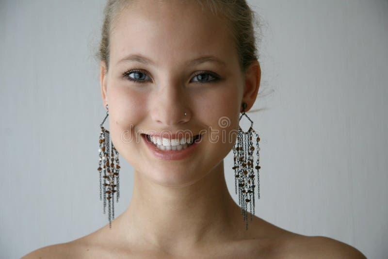 Mädchenespritohrringe stockbild