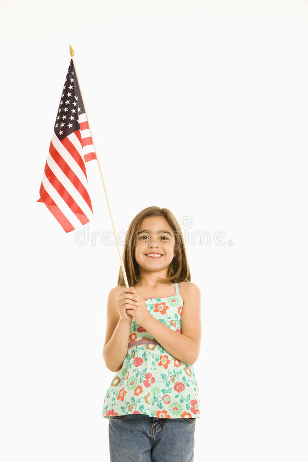 Mädchenholding amerikanische Flagge. stockbild
