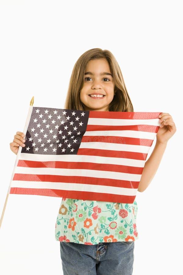 Mädchenholding amerikanische Flagge. lizenzfreies stockfoto