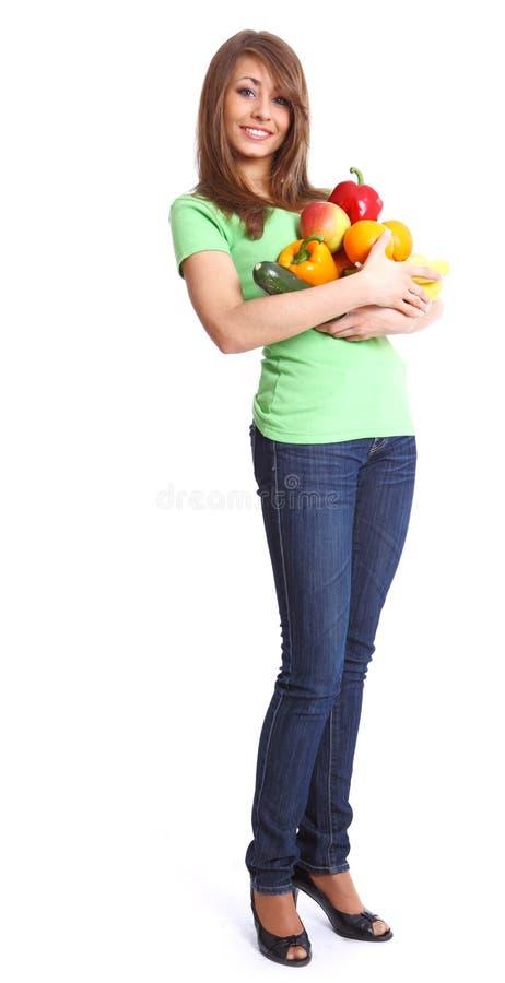 Mädchenholding in den Händen voll der verschiedenen Früchte stockbilder