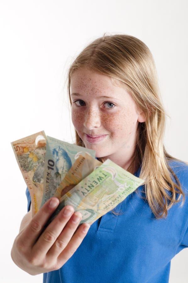 Mädchenholding Geld lizenzfreies stockbild