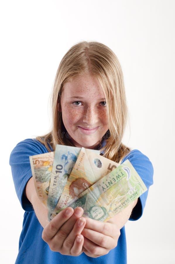 Mädchenholding Geld stockfoto