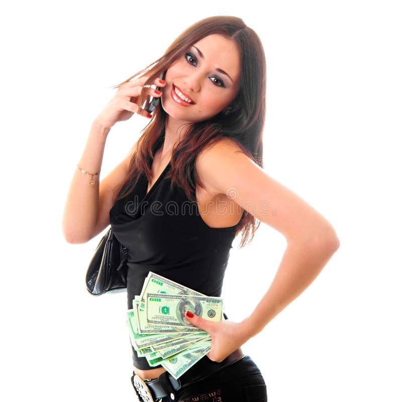 Mädchenholdinggeld und Benennen durch Zelle lizenzfreie stockfotos