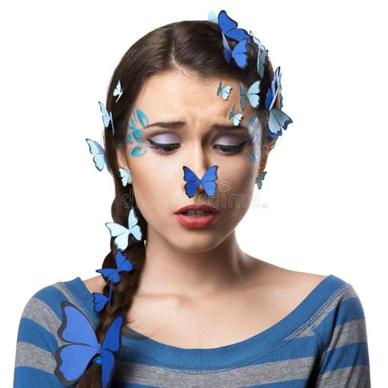 Mädchenkunstmake-up mit Schmetterlingen stockfotografie