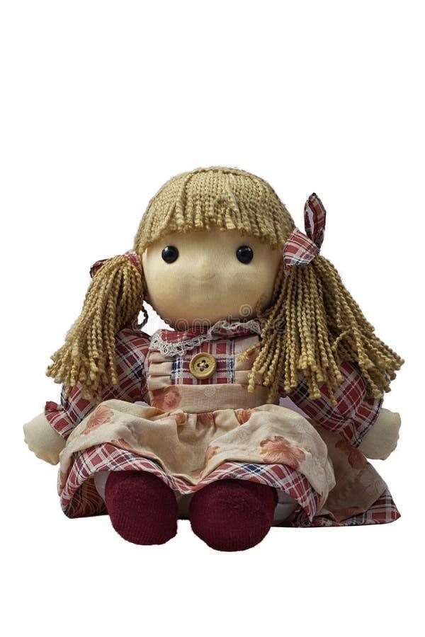 Mädchenspielzeugpuppe lizenzfreie stockbilder