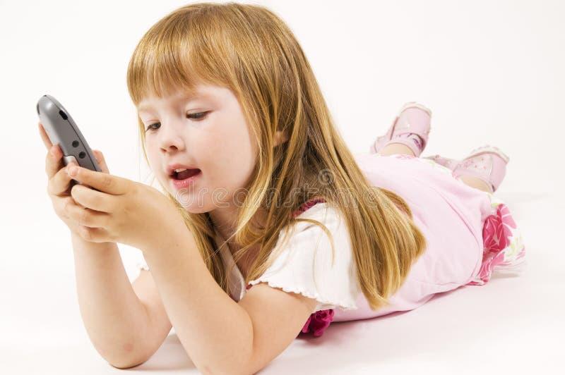 Mädchenvorwahlknopf eine Zahl stockfoto