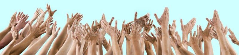 Män och kvinnors händer som lyfts upp royaltyfri foto